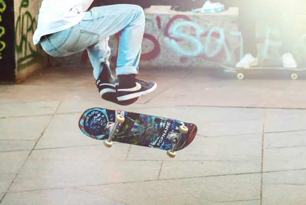 skateboarder mid trick with the best skateboard deck for street